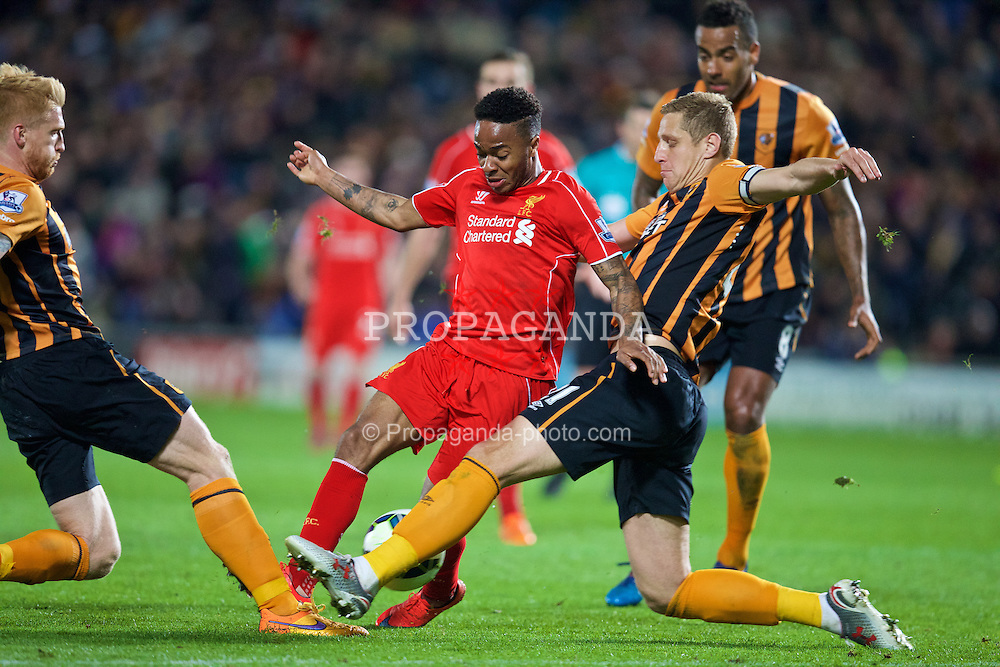 KINGSTON-UPON-HULL, ENGLAND - Tuesday, April 28, 2015: Liverpool's Raheem Sterling is tackled by Hull City's Paul McShane [L] and Michael Dawson [R] during the Premier League match at the KC Stadium. (Pic by David Rawcliffe/Propaganda)