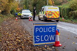 © Licensed to London News Pictures. 24/10/2020. Watlington Hill, UK. A police road block outside The Fox & Hounds pub, police are tentatively linking the murder investigation to reports of a man acting suspiciously near the pub in the Christmas Common area of Watlington at around 3.30pm on Friday 23/10/2020. A murder investigation has been launched by Thames Valley Police after the body of a woman in her sixties was located in woodland in the Watlington Hill National Trust Estate at approximatly 5:53pm on Friday 23/10/2020. Photo credit: Peter Manning/LNP