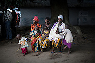 DRC / Burundi Refugees / Women seat with their children on a bench outside of their tent in Kavimvira transit<br /> centre run by UNHCR in Uvira, DRC's South Kivu Province.<br /> 700 vulnerable Burundian refugees are hosted in Kavimvira transit centre. The<br /> majority are women and children.<br /> <br /> More than 9000 Burundians refugees have crossed into the DRC over the past few weeks. The new<br /> arrivals are being hosted by local families, but the growing numbers are straining<br /> available support. UNHCR is helping some 700 vulnerable refugees at a transit centre<br /> at Kavimvira and in another centre at Sange. Work is ongoing to identify a site<br /> where all the refugees can be moved, and from where they can have access to<br /> facilities such as schools, health centers and with proper security. / UNHCR / F.Scoppa / May 2015