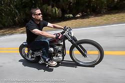 Bryan Lane of Charlotte, NY rides his custom Harley-Davidson Panhead through Tamoka State Park during Daytona Beach Bike Week  2015. FL, USA. Friday, March 13, 2015.  Photography ©2015 Michael Lichter.