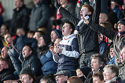 Falkirk's away fans celebrate after David McCracken scored their second goal<br /> Raith Rovers 2 v 4 Falkirk, Scottish Championship game today at Starks Park.<br /> © Michael Schofield.