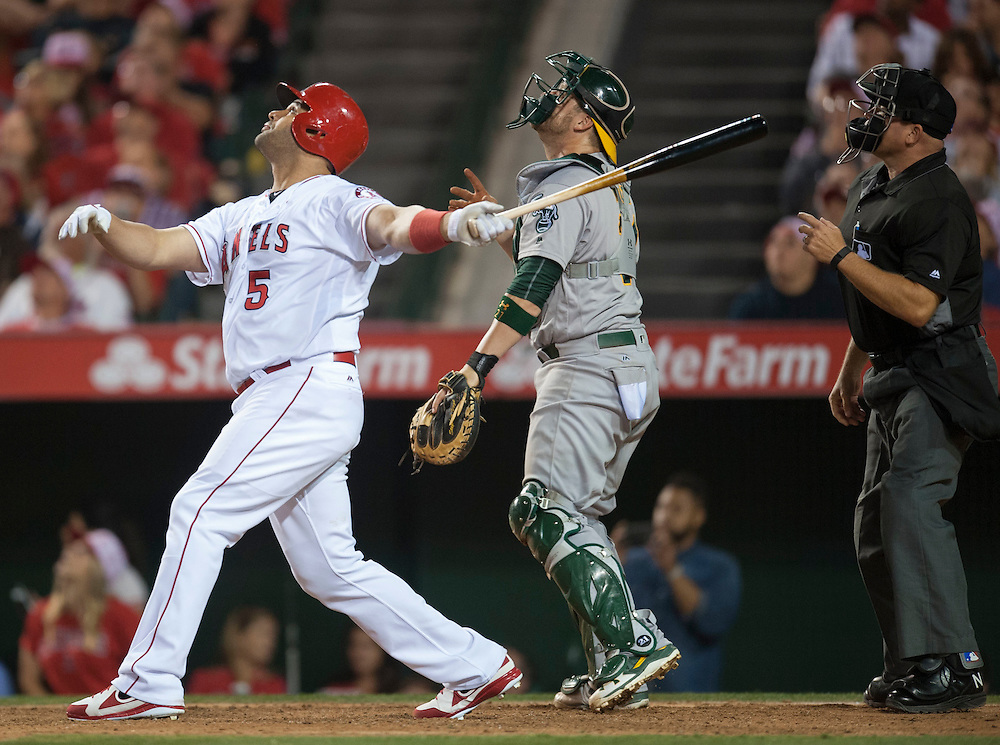 The Angels' Albert Pujols fouls out in the seventh inning in front of Athletics' catcher Stephen Vogt at Angel Stadium on Friday.<br /> <br /> ///ADDITIONAL INFO:   <br /> <br /> angels.0625.kjs  ---  Photo by KEVIN SULLIVAN / Orange County Register  --  6/24/16<br /> <br /> The Los Angeles Angels take on the Oakland Athletics Friday at Angel Stadium.<br /> <br /> <br />  6/24/16