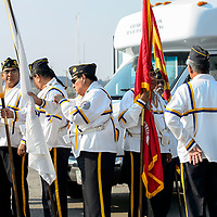 Members of the Ira H. Hayes Post 84 Color Guard prepare for the Navajo Code Talkers Parade in Window Rock, AZ on Aug. 14, 2018.