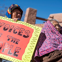 122314       Cable Hoover<br /> <br /> Carol Brown, left, and Marjorie Thomas bundle up against the cold as they participate in a voting protest in Window Rock Tuesday.