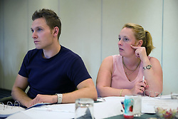 Youth Justice staff members listening during training,