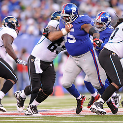 Defensive tackle Rocky Bernard #95 of the New York Giants breaks through the offensive line during NFL football action between the New York Giants and Jacksonville Jaguars on Nov. 28, 2010 at MetLife Stadium in East Rutherford, N.J.
