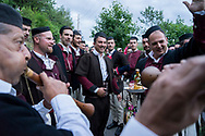 Saturday evening; Welcoming the Musicians ceremony, the groom leading the processiongs in the streets of Galichnik, Galichnik Wedding Festival, Macedonia