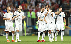 Russia's Sergei Ignashevich, Mario Fernandes, Vladimir Granat,  Aleksandr Yerokhin, Fyodor Kudryashov and Roman Zobnin celebrate defeating Spain by 4-3 on penalties