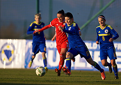 ZENICA, BOSNIA AND HERZEGOVINA - Tuesday, November 28, 2017: Wales' Natasha Harding and Bosnia and Herzegovina's Amela Kršo during the FIFA Women's World Cup 2019 Qualifying Round Group 1 match between Bosnia and Herzegovina and Wales at the FF BH Football Training Centre. (Pic by David Rawcliffe/Propaganda)