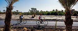 Children make their way to school on bicycles in the early morning in the town of Skoura, Morocco<br /> <br /> (c) Andrew Wilson | Edinburgh Elite media