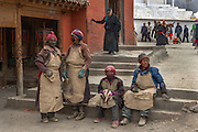 Devout pilgrims prostrate themselves thousands of times in their arduous quest for enlightenment.<br /> <br /> Each day during Losar (Tibetan New Year),thousands of pilgrims walk the kora around Labrang Monastery, the largest in Amdo Province, and indeed China.<br /> <br /> Established in 1709, Labrang housed over 4000 monks at its peak, but now only has around 1500 monks.