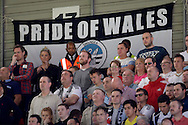 Swansea City  fans watching the game with a 'Pride of Wales' banner being hung during the match. Barclays Premier League, Watford v Swansea city at Vicarage Road in London on Saturday 12th September 2015.<br /> pic by John Patrick Fletcher, Andrew Orchard sports photography.