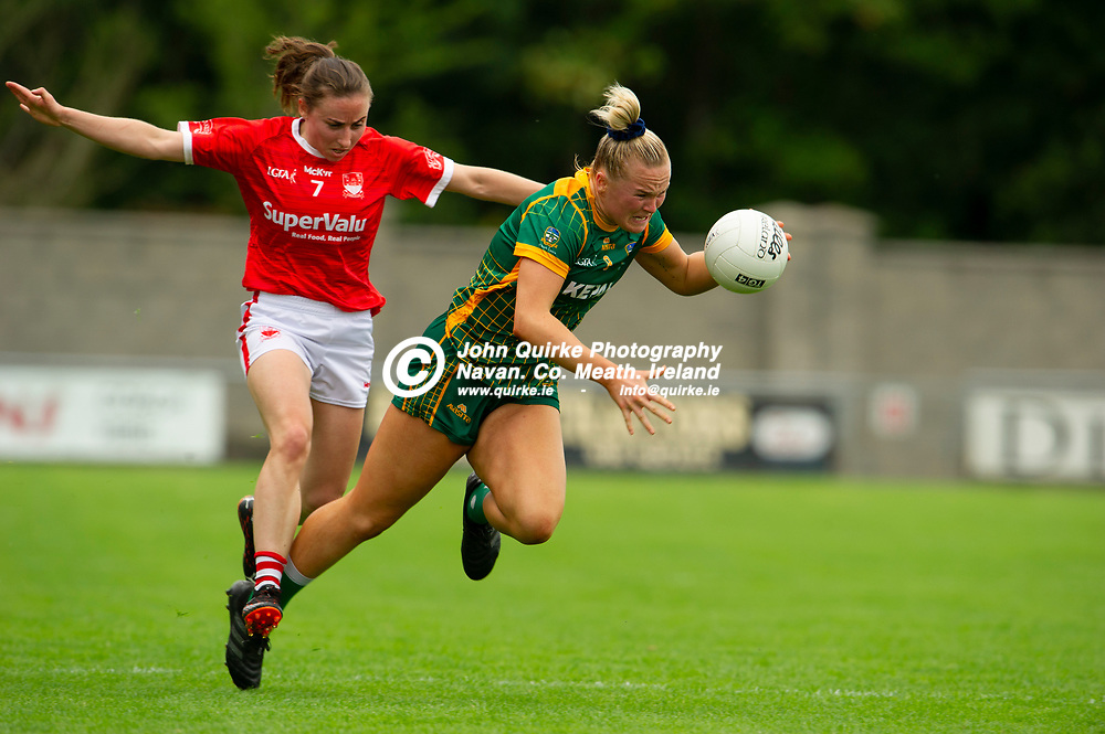 10-07-21. Meath v Cork - LGFA All-Ireland Senior Championship - Group 3 Round 1 at St. Brendan's Park, Birr.<br /> Vikki Wall, Meath is tripped by Melissa Duggan, Cork.<br /> Photo: John Quirke / www.quirke.ie<br /> ©John Quirke Photography, 16 Proudstown Road, Navan. Co. Meath. (info@quirke.ie / 046-9028461 / 087-2579454).