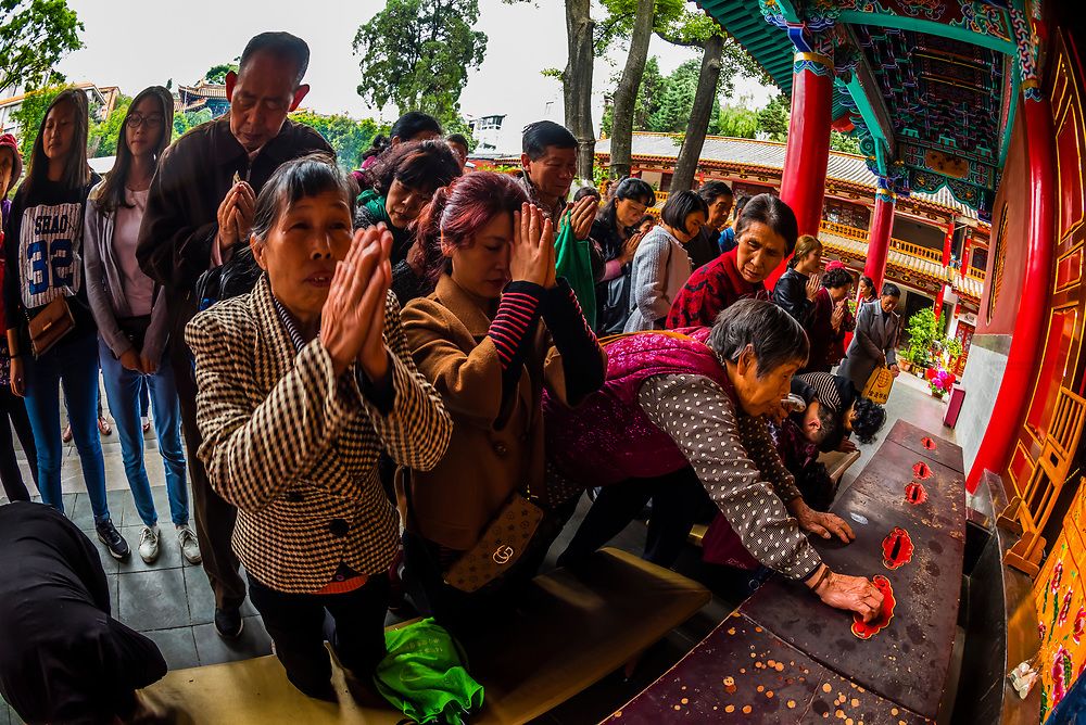 Buddhists praying at the Yuantong Temple, the largest Buddhist temple in Kunming, Yunnan Province, China. It was first built in the late 8th and early 9th century, the time of the Nanzhao Kingdom in the Tang dynasty.