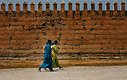 A group of Moroccan women pass by the old Palace walls of Bab Makina in Fes, Morocco on Friday morning, June 08, 2007. Bab Makina is the main venue for the annual Fes Festival of World Sacred Music. The festival in held in Fes for the past thirteen years. (PHOTO BY TIMOTHY D. BURDICK).