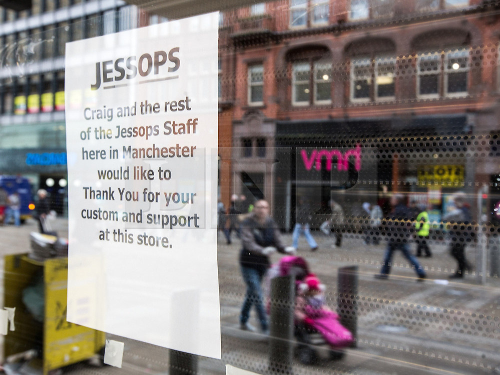 © Licensed to London News Pictures . 08/02/2013 . Manchester , UK . Message in the window of a closed Jessops camera shop with shoppers and HMV branch opposite , reflected in the window , on Manchester's Market Street . Photo credit : Joel Goodman/LNP