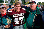 Augsburg College football player and parents age 21 and 57 at Macalester game.  Minneapolis Minnesota USA