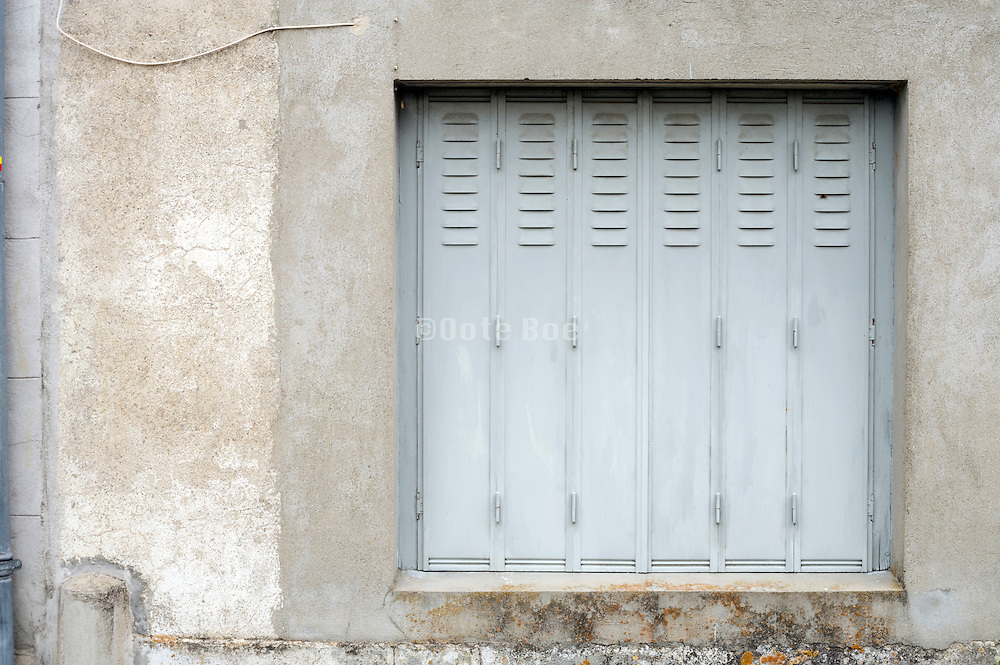 window closed with metal shutters
