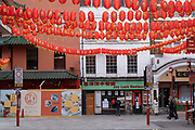 Red lanterns on Gerrard Street ready for Chinese New Year at Chinatown as the national coronavirus lockdown three continues on 5th March 2021 in London, United Kingdom. With the roadmap for coming out of the lockdown has been laid out, this nationwide lockdown continues to advise all citizens to follow the message to stay at home, protect the NHS and save lives, and the streets of the capital are quiet and empty of normal numbers of people.