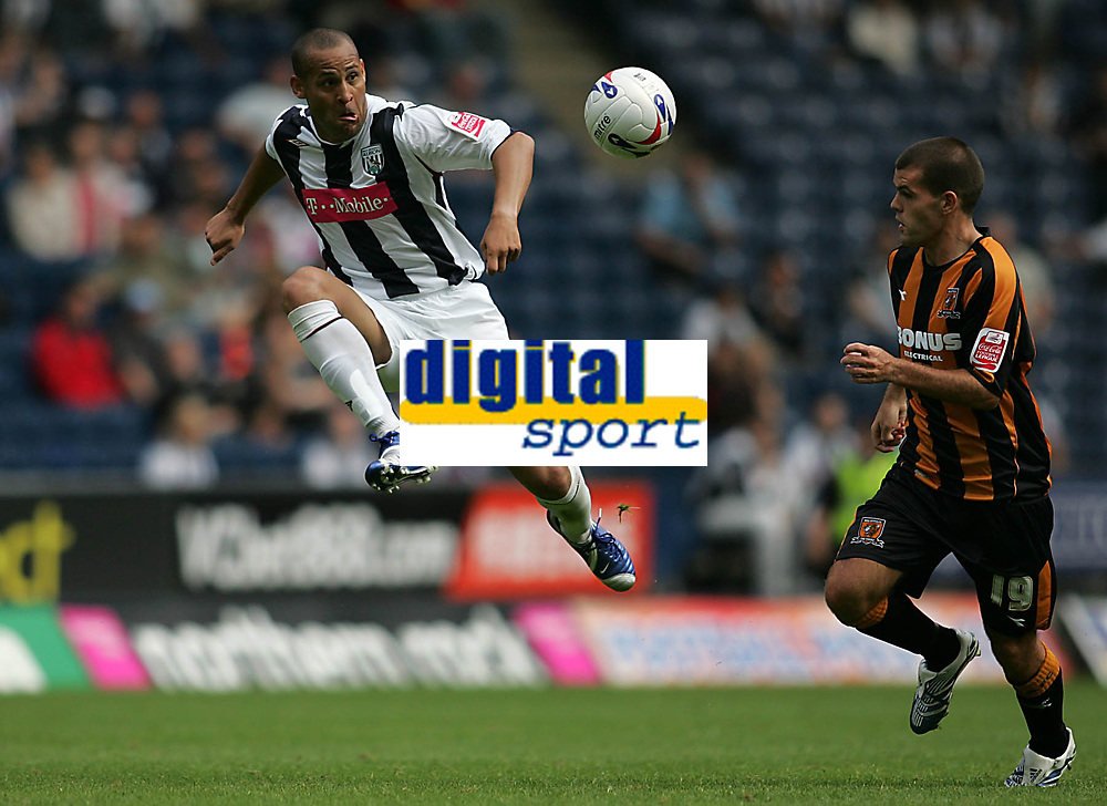 Photo: Lee Earle.<br /> West Bromwich Albion v Hull City. Coca Cola Championship. 05/08/2006. Albion's Nigel Quashie (L) clears from John Welsh.
