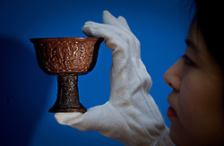 © London News Pictures. 04/11/2011. London, UK. A carved 17th century rhinoceros horn 'hundred boys' stem cup, which has been unseen by the public for at least £80 years,  estimated to fetch between £300,000 and £500,000 at a Christie's auction of Fine Chinese Ceramics and Works of Art on November 8th 2011. The auction, which is led by seven private collections, is expected to realise in excess of £15 million. Photo Credit : Ben Cawthra/LNP