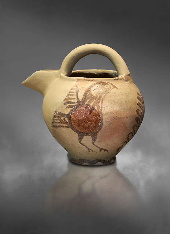 Bridge spouted jug bird decorated. Early Cycladic I (1650-1550 BC); Phylakopi; Melos. National Archaeological Museum Athens. Cat No 5768.  Gray background.<br /> <br /> <br /> During this Cycladic period the pottery designs were heavily influenced by Cretean minoan with pottery like this using bird patterns. .<br /> <br /> If you prefer to buy from our ALAMY PHOTO LIBRARY  Collection visit : https://www.alamy.com/portfolio/paul-williams-funkystock/cycladic-art-artefacts.html Type into the LOWER SEARCH WITHIN GALLERY box to refine search by adding background colour, place, museum etc<br /> <br /> Visit our CYCLADIC CIVILISATIONS PHOTO COLLECTIONS for more photos to download or buy as wall art prints https://funkystock.photoshelter.com/gallery-collection/Cycladic-civilisation-Ancient-Greek-Artefacts-art-Photos-Pictures-Images/C0000CmevVvnC.XU