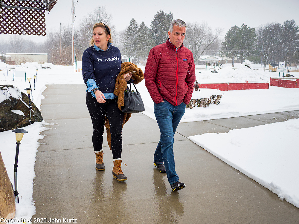 "24 JANUARY 2020 - POLK CITY, IOWA: LUCY CALDWELL and JOE WALSH walk through a snowstorm into a campaign event in Polk City, northwest of Des Moines, Caldwell is Walsh's campaign manager. Walsh, a conservative radio personality, former Republican congressman, and one time supporter of Donald Trump is now challenging Trump for the Republican nomination for the US Presidency. During his appearance in Polk City, Walsh said Trump is unfit to be the President because he is a ""cheater,"" a climate change denier, and a ""threat"" to the United States.       PHOTO BY JACK KURTZ"