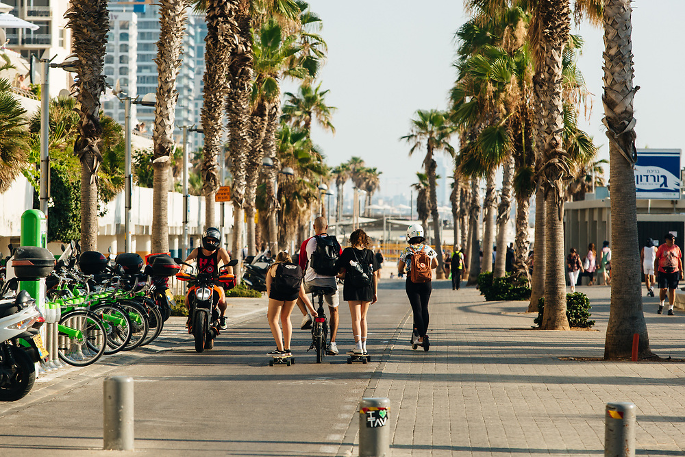 People are seen along the beach promenade (Shlomo Lahat Promenade) in Tel Aviv, Israel, on July 4, 2018. The promenade (commonly referred to in Hebrew simply as the Tayelet) runs along the Mediterranean seashore from the port of Tel Aviv to the Jaffa Port.
