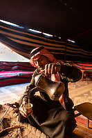 Bedouin man serving coffee in his tent, Wadi Rum, Jordan.