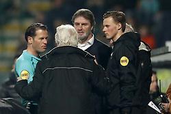 (L-R) referee Danny Makkelie, 4th official Sander van der Eijk interrupt match during the Dutch Eredivisie match between ADO Den Haag and NAC Breda at Cars Jeans stadium on March 10, 2018 in The Hague, The Netherlands