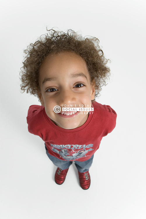 Little boy looking up and smiling,