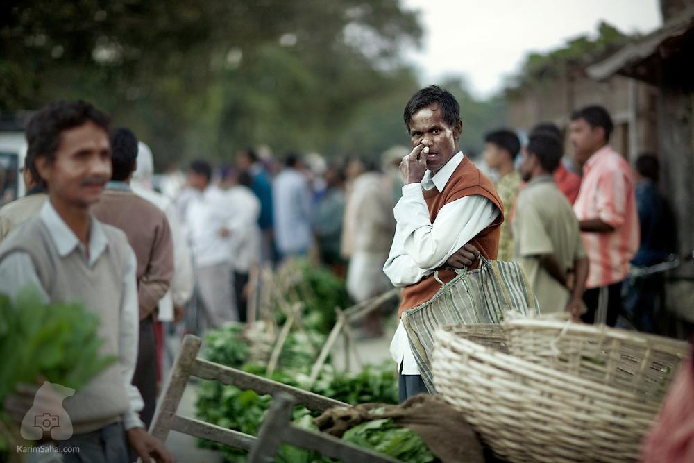 Man at the Hinimari market near Guwahati, Assam, India.
