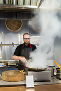A demonstration of Cinese cooking style at the Museum of Food and Drink.