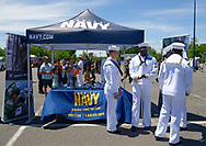 East Meadow, New York, USA. May 25, 2019. Families visit recruitment booth at the U.S. Navy hosted aviation event on Memorial Day Weekend at Eisenhower Park on Long Island. NOSC Long Island - Navy Operational Support Center, is supporting recruitment to the Navy as part of Fleet Week.
