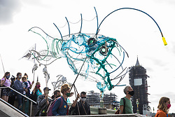 Climate activists from the Ocean Rebellion carry a large fish model during a colourful Marine Extinction March on 6 September 2020 in London, United Kingdom. The activists, who are attending a series of September Rebellion protests around the UK, are demanding environmental protections for the oceans and calling for an end to global governmental inaction to save the seas.