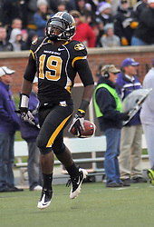 Nov 13, 2010; Columbia, MO, USA; Missouri Tigers defensive back Carl Gettis (19) celebrates after making an interception in the second half against the Kansas State Wildcats at Memorial Stadium. Missouri won 38-28.  Mandatory Credit: Denny Medley-US PRESSWIRE