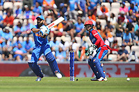 Cricket - 2019 ICC Cricket World Cup - Group Stage: India vs. Afghanistan<br /> <br /> India's captain Virat Kohli hits a four on his way to 67 before being caught by Rahmat Shah of Afghanistan of the bowling of Mohammad Nabi of Afghanistan at the Hampshire Bowl, Southampton. <br /> <br /> COLORSPORT/SHAUN BOGGUST