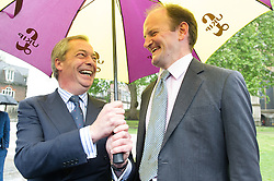© London News Pictures. 18/05/15. London, UK. Nigel Farage, leader of the UKIP party, and Douglas Carswell UKIP MP, before they sign a petition for electoral reform, Westminster, Central London. Photo credit: Laura Lean/LNP/05/15.