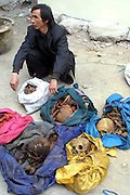 Man Digs Grave And Sells Bones For Ghost Marriage<br /> <br /> The image shows Yang Jinyu, a peasant from Xinghuo Village with the six skeletons of adult female he stolen to sell for ghost marriage on March 28, 2005 in Xi'an, Shaanxi Province of China. Yang Jinyu, a peasant from Xinghuo Village in Shaanxi digged several graves and collected six skeletons of adult female from his village after hearing that a skeleton could be sold for up to 300 to 500 RMB (about 48 to 80 USD) for ghost marriage when he worked in Shanxi. But on Yang's way to Shanxi, he was suspected and caught by policeman at Xi'an Railway Station on March 28, 2005.<br /> ©Exclusivepix Media