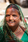 Indian woman with traditional nose jewel in old town Udaipur, Rajasthan, Western India
