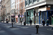 Oxford Street, Londons main shopping and retail area normally full of thousands of shoppers and traffic is virtually deserted and with most shops closed due to the Coronavirus outbreak on 23rd March 2020 in London, England, United Kingdom. Following government advice most shoppers are staying at home leaving the streets quiet, empty and eerie. Coronavirus or Covid-19 is a new respiratory illness that has not previously been seen in humans. While much or Europe has been placed into lockdown, the UK government has announced more stringent rules as part of their long term strategy, and in particular social distancing.