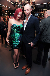 BRIAN FRIEDMAN and CARMIT BACHAR at a party hosted by InStyle to celebrate the iconic glamour of Dolce & Gabbana held at D&G, 6 Old Bond Street, London on 3rd November 2010.
