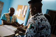 Staff from UNICEF-partner organization OIS Afrique discuss with police officers at the police station in the town of Katiola, Cote d'Ivoire on Saturday July 13, 2013.