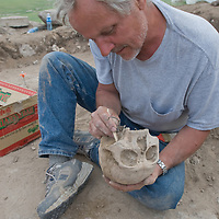 MONGOLIA. Smithsonian archaeologist & forensics specialist, Dr. Bruno Frohlich, unearths bronze-age skeleton at site above Delger River near Muren.  Skeleton may be 3700+ years old.