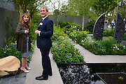 """© Licensed to London News Pictures. 20/05/2013. London, UK (l-r) Garden Designer Jo Thompson and Secretary of State for the Environment Owen Patterson in the """"Stop the Spread"""" garden.  Press day at Chelsea Flower Show 2013. The centenary edition of the show attracts large number of visitors and is already sold out before opening day. Photo credit : Stephen Simpson/LNP"""