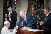 Pope Francis shakes hands with Vice President Joe Biden as he arrives in the chamber of the House of Representatives as he continues his six-day U.S. tour speaking to a joint meeting of Congress at the U.S. Capitol in Washington, District of Columbia, U.S., on Thursday, Sept. 24, 2015. The Pope is calling for Americans to do more to fight poverty, curb climate change and help immigrants. His visit runs through Sept. 27, and features stops in Washington, New York and Philadelphia. Photographer: Pete Marovich/Bloomberg