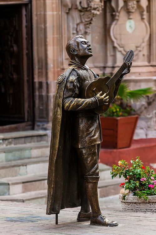Statue of an estudiantina (minstrel), Teatro Juarez (theatre), Guanajuato, Mexico