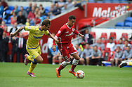 Ravel Morrison of Cardiff city ® makes a break on his debut . Skybet football league championship match, Cardiff city v Sheffield Wed at the Cardiff city stadium in Cardiff, South Wales on Saturday 27th Sept 2014<br /> pic by Andrew Orchard, Andrew Orchard sports photography.