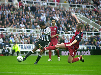 Photo. Glyn Thomas<br />Newcastle United v Bolton Wanderers. <br />Barclaycard Premiership.<br />St James' Park, Newcastle. 20/09/2003.<br />Bolton's Kevin Nolan (R) flies in to block a shot from Nolberto Solano.