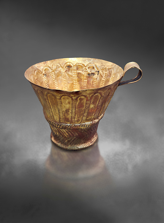 Mycenaean gold cup with arches decoration, Grave V, Grave Circle A Mycenae, Greece. National Archaeological Museum of Athens.  Grey Art Background<br /> <br /> An elegant precious gold cup hammered from thick gold to created a simple elegant design. This Mycenaean gold cup demonstrates how advance Mycenaean metalworking was in the 16th century BC. The value of the cup would have been extermely high so must have graced the table of a Mycenaean noble perhaps even a v king. .<br /> <br /> If you prefer to buy from our ALAMY PHOTO LIBRARY  Collection visit : https://www.alamy.com/portfolio/paul-williams-funkystock/mycenaean-art-artefacts.html . Type -   Athens    - into the LOWER SEARCH WITHIN GALLERY box. Refine search by adding background colour, place, museum etc<br /> <br /> Visit our MYCENAEN ART PHOTO COLLECTIONS for more photos to download  as wall art prints https://funkystock.photoshelter.com/gallery-collection/Pictures-Images-of-Ancient-Mycenaean-Art-Artefacts-Archaeology-Sites/C0000xRC5WLQcbhQ